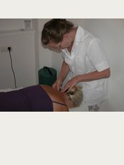 Phoenix Acupuncture - Deeva Eastwood giving a treatment