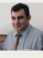 Dr. Maaz Ul Hassan - Al-Razi Healthcare - 2-C, M.M. Alam Road, Lahore,