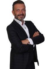 Herr Teoman Serkan Ünlüer - Geschäftsführer - Aesthetic Travel