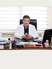 Prof. Dr. Haluk Ünalp - Ali Çetinkaya bulvarı 31/8, Alsancak, Izmir,