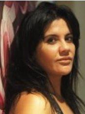 Ms Florina Luhan -  at Skintopia Yoga and Wellness Sanctuary