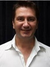 Dr.  Marko Lambassa - Doctor at Rachel Lavelle Beauty Couture and Medispa