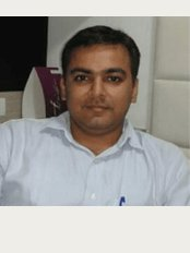 Manas Skin Care Clinic - Shanti Arcade Complex, AEC Cross Road,Naranpura, Ahmedabad, 380013,