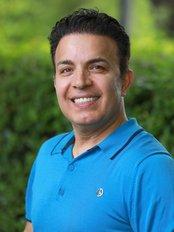 Mr Fash Assadi - Dentist at Yugen Clinic