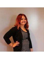 Miss Angellisa  McGarity -  at Vibrant Salon & Spa