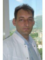 Alek Topov - Principal Surgeon at Tokuda Hospital
