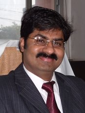 Dr. R. K. Mishra- Plastic & Cosmetic Surgeon -SIPS - Dr R K Mishra
