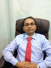 Dr Samir Ahire - Principal Surgeon at EVOLVE COSMETIC CLINIC