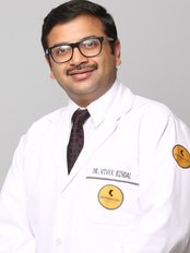 Dr Vivek Bindal - Surgeon at Skinnovation Clinics - The World of Aesthetics