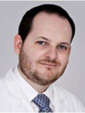 Alberto Garcia -  at Cosmed Clinic