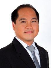 Dr. Karlo Capellan - Symmetry Plastic Surgery - DR Karlo Capellan
