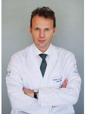 Dr Dominik Boligłowa - Surgeon at Allmedica