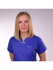 Dr ALEKSANDRA LUNIEWSKA - Principal Surgeon at CORAMED Beauty Surgery