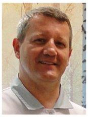 Dr. Tomasz Kalinowski - Stomatologist, Implantologist - Leitender Zahnarzt - PolMed Travel