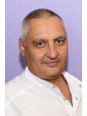 Dr Oleg Turkin Ph.D - Surgeon at New Look Holiday