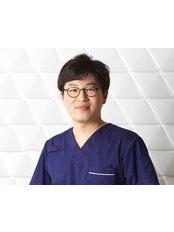 Dr Kang Sungeyeop -  at Reborn Plastic Surgery Clinic