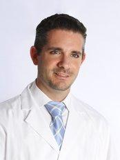 Juan Martínez Gutiérrez - Principal Surgeon at Consulta Dr. Juan Martínez Gutiérrez-Pomegranate
