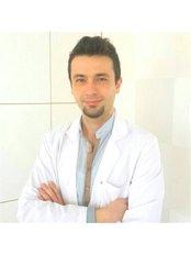 Dr. Aykut Yuceer Dentist - Zahnarzt - Talya Medical Center