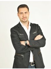 Доктор Gokhan Haytoglu - Врач хирург в Op. Dr. Gokhan HAYTOGLU CLINIC