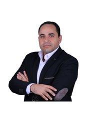 Dr Khaled Amer -  at Bizrah Medical Centre