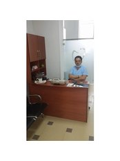 Dr Eltjon Hasanaj - Dentist at HasanajDental   Fier
