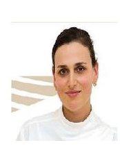Dr Alena Brichko - Dentist at Bright Star Dental Centre