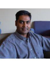 Dr Asheen Behari - Associate Dentist at St. Quentin Dental