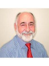 Dr John Owen AM - Oral Surgeon at Midland Orthodontics