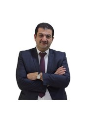 Dr Anas Tawfiq - Orthodontist at Muna Dental Care Center