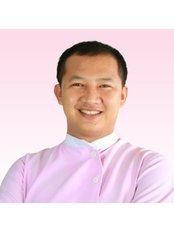 Dr Ke Chenda - Dentist at Roomchang Dental & Aesthetic Hospital