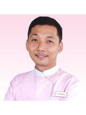 Dr Ping Bushara - Dentist at Roomchang Dental & Aesthetic Hospital