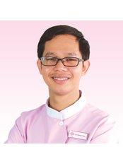 Dr Khoun Tola - Dentist at Roomchang Dental & Aesthetic Hospital