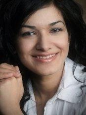 Dr Rakhi Palta -  at Derry Village Dental Care