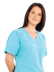 Dr Carolina Salazar - Dentist at Dr. Guillermo Bernal Estetica y Rehabilitacion Oral Avanzada