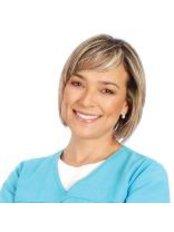 Dr Claudia Prieto - Dentist at Dr. Guillermo Bernal Estetica y Rehabilitacion Oral Avanzada
