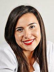 Dr. Selena Cubero - Dentist at Premier Dental Care Center