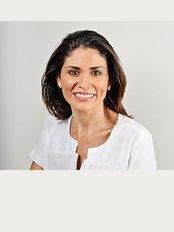 Premier Dental Care Center - Dra. Aura Nunez