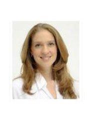 Dr Evelyn Loaiza - Dentist at Loaiza and Meneses - Clínica de Especialidades Dentales