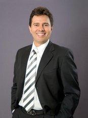 Dr Mario Garita -  at Mario E. Garita DDS