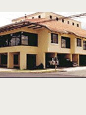 Costa Rica Implants - One Block South from McDonalds, Yellow Building, Second Floor, La Sabana,
