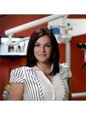 Dr Carolina Jamienson -  at Dent-Ofimall Especialidades Dentales
