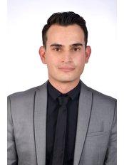 Dr. Alex Villalobos - Dentist at Jehova Rafa Dental Center