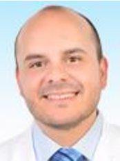 Dr Carlos Truque - Dentist at Truque Argüello Dental