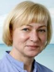 Dr Ene Palmer - Dentist at Vagodent Dental Clinic