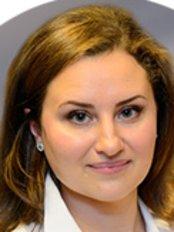 Dr Olena Melnikova - Dentist at Zahnarztpraxis Dr. Roman Kogan