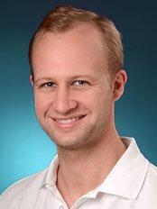 Dr Jan Uli Schmitz - Dentist at Dr. Med. Dent. H. Zieger Zahnarzt