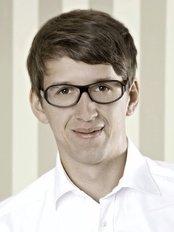 Dr Florian Kunkel - Dentist at Zahnarztpraxis Dr. Waldmann and Dr. Kunkel