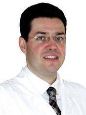 Mario R. Ganddini DDS MS - 13 Calle 1-10, Zona 10, Edificio Dubai Center, Oficina 509, Guatemala,  0