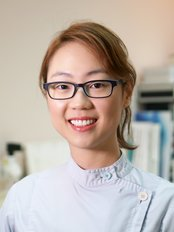 Dr Lois Law - Dentist at Orthodontic and Children's Dental Center - Kowloon