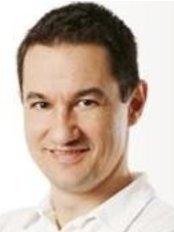Dr Attila Jankó - Dentist at Artoral Dental Center